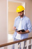 Casual architect reading his notes — Stock Photo
