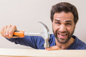 Casual man hammering his finger by accident — Photo