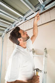 Construction worker fixing the ceiling — Stock Photo