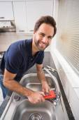 Man fixing tap with tool — Stock Photo