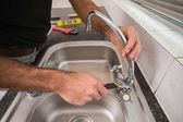 Plumber fixing the sink with wrench — Stock Photo