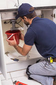 Plumber fixing under the sink — Stock Photo