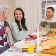 Cheerful family having christmas dinner together — Stock Photo #60892913