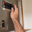 Electrician working on the fuse box — Stock Photo #60915065