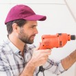 Construction worker drilling hole in wall — Stock Photo #60919725