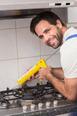 Plumber putting filling in between tiles — Stock Photo
