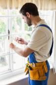 Handyman fixing a window — Stockfoto