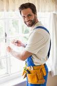 Handyman fixing a window — Stock Photo