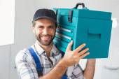 Plumber holding toolbox on shoulder — Stock Photo