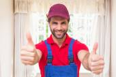 Construction worker showing thumbs up — Stock Photo