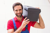 Construction worker holding tool box — Stock Photo