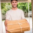 Delivery man offering parcel — Stock Photo #60921111