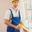 Man putting filling between window and wall — Stock Photo #60926443