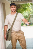 Postman delivering a letter — Stock Photo