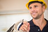 Construction worker posing with cables — Stock Photo