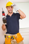 Construction worker posing while holding power tool — Foto Stock