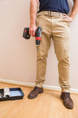 Construction worker holding power tool — Stock Photo