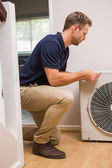 Focused handyman fixing air conditioning — Stock Photo