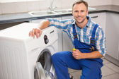 Handyman fixing a washing machine — Stock Photo