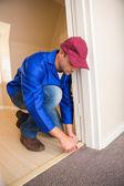 Handyman laying down a carpet — Stock Photo