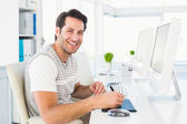 Casual man working at desk with computer and digitizer — Stock Photo