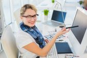 Attractive photo editor pointing at the screen — Stock Photo