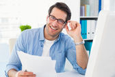 Smiling photo editor at work holding contact sheet — Stock Photo