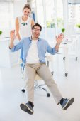 Man on swivel chair with hands up — Stock Photo