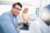 Designer using a graphics tablet while looking at camera — Stock Photo