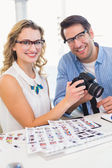 Portrait of photo editors with camera — Stock Photo