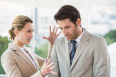 Woman shouting at male colleague — Stock Photo