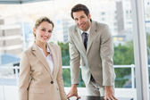 Business people posing and smiling at camera — Stock Photo