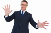 Smiling businessman in glasses with arms out — Stock Photo