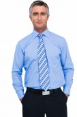 Cheerful businessman with hands in pocket posing — Foto Stock