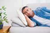 Man with grey hair sleeping on the couch — Stock Photo