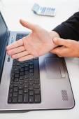 Hand of man touching his wrist — Stock Photo