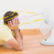 Man lying on floor looking at fan at home  — Stock Photo #60977615