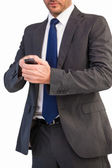 Focused businessman texting on his mobile phone — Stock Photo