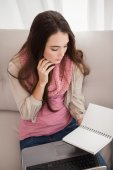 Pretty brunette studying with laptop — Stock Photo