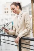 Young businesswoman sending a text — Stock Photo