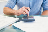 A businessman working on his finances at his desk — Stock Photo