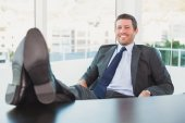 Relaxed businessman with his feet up  — Stock Photo