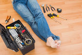 Man legs with toolbox on floor at home  — Stock fotografie