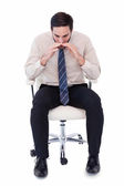 Businessman sitting on swivel chair shouting — Stock Photo