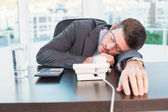 Exhausted businessman sleeping at his desk  — Stock Photo