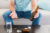 Man with a beer and his medicine laid  — Stock Photo