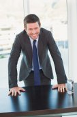 Smiling businessman at his desk — Stock Photo