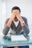Worried businessman with head in hands — Stock Photo