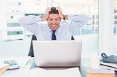Smiling businessman  taking his head  — Stock Photo