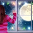 Little girl waving to santa flying past full moon — Stock Video #61018503